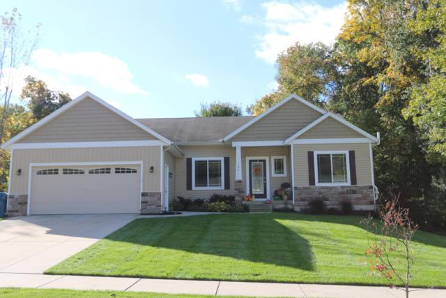 174 Evan Drive NE, Comstock Park, MI 49321 (MLS #18051650) :: Matt Mulder Home Selling Team