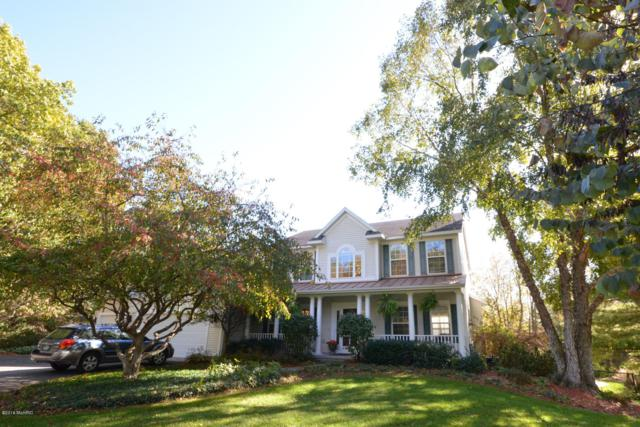 4954 Glen Oaks Drive NE, Rockford, MI 49341 (MLS #18051904) :: Matt Mulder Home Selling Team