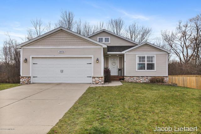 3972 Macey Drive NW, Grand Rapids, MI 49534 (MLS #18057339) :: Deb Stevenson Group - Greenridge Realty