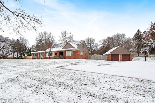 3101 Springbrook Drive NW, Grand Rapids, MI 49544 (MLS #18057466) :: Deb Stevenson Group - Greenridge Realty