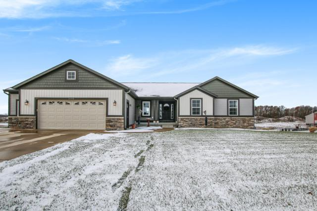 1645 Roaming Court NE, Grand Rapids, MI 49525 (MLS #18057537) :: Deb Stevenson Group - Greenridge Realty