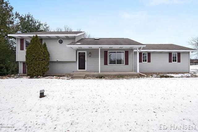 6959 10 Mile Road NE, Rockford, MI 49341 (MLS #18058021) :: Matt Mulder Home Selling Team