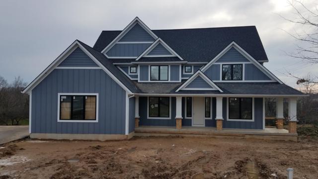 4450 Birch Point Drive NE, Grand Rapids, MI 49525 (MLS #18058444) :: Matt Mulder Home Selling Team
