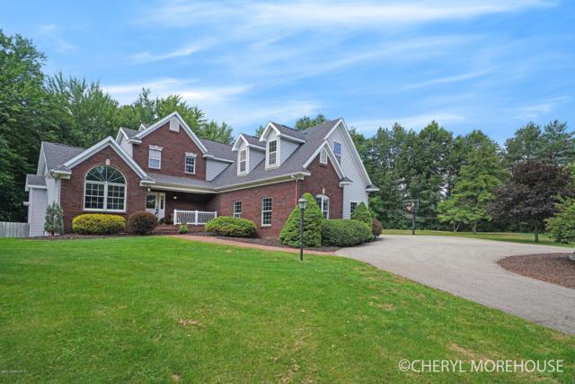 5045 Weeping Willow Drive SE, Grand Rapids, MI 49546 (MLS #18059460) :: Matt Mulder Home Selling Team