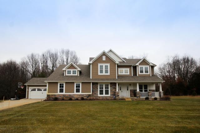 5870 Summerset Woods Drive SE, Alto, MI 49302 (MLS #19001902) :: Matt Mulder Home Selling Team