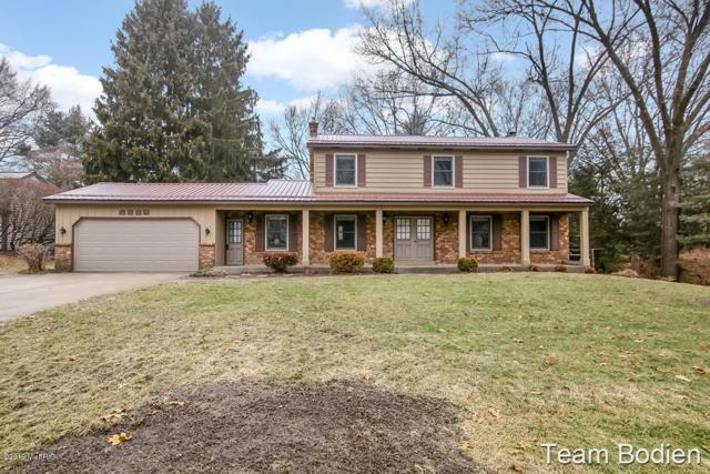 6889 Woodbrook Drive SE, Grand Rapids, MI 49546 (MLS #19002118) :: Matt Mulder Home Selling Team