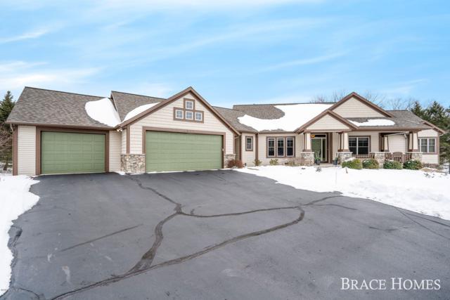 2600 Sturbridge Drive SE, Ada, MI 49301 (MLS #19006180) :: Matt Mulder Home Selling Team