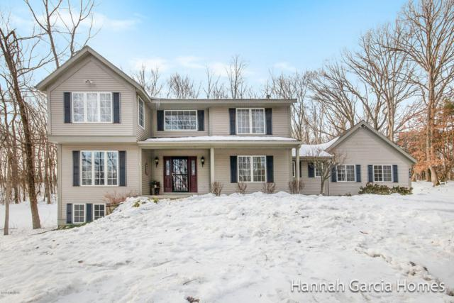 7630 Sun Quest Ridge NE, Ada, MI 49301 (MLS #19008929) :: JH Realty Partners