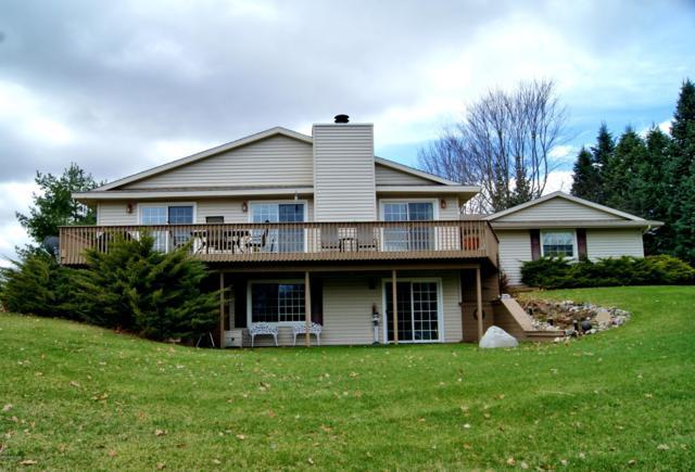 8388 Peninsula Drive E, Canadian Lakes, MI 49346 (MLS #19015652) :: Matt Mulder Home Selling Team