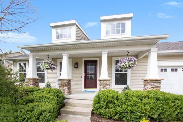 451 Greystone Drive NE, Rockford, MI 49341 (MLS #19019978) :: Matt Mulder Home Selling Team