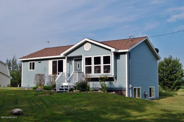 8921 Lake Road, Six Lakes, MI 48886 (MLS #19031925) :: Deb Stevenson Group - Greenridge Realty