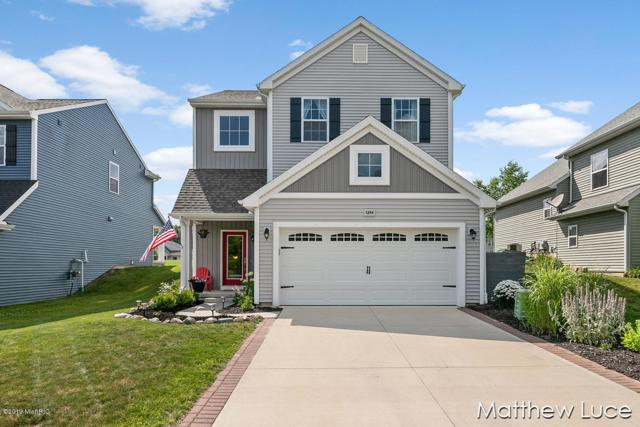 1244 Highland Hill Drive SE, Lowell, MI 49331 (MLS #19032346) :: JH Realty Partners