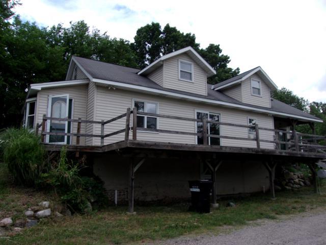 8826 Alaska Avenue SE, Caledonia, MI 49316 (MLS #19033054) :: Deb Stevenson Group - Greenridge Realty