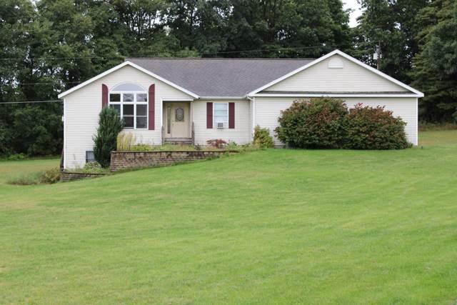 2200 Broken Arrow Street NE, Cedar Springs, MI 49319 (MLS #19044835) :: Deb Stevenson Group - Greenridge Realty