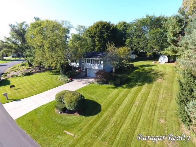 5595 Riverlook Drive NE, Comstock Park, MI 49321 (MLS #19049835) :: CENTURY 21 C. Howard