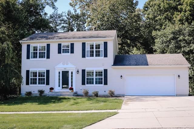 5805 Grand Oaks Drive NE, Comstock Park, MI 49321 (MLS #19049952) :: JH Realty Partners