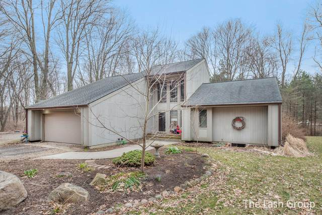 10325 Deer Creek Drive SE, Ada, MI 49301 (MLS #20010748) :: JH Realty Partners