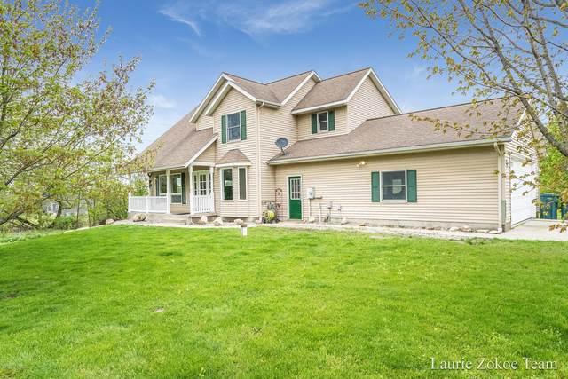 569 Leonard Street NW, Grand Rapids, MI 49534 (MLS #20017466) :: Deb Stevenson Group - Greenridge Realty