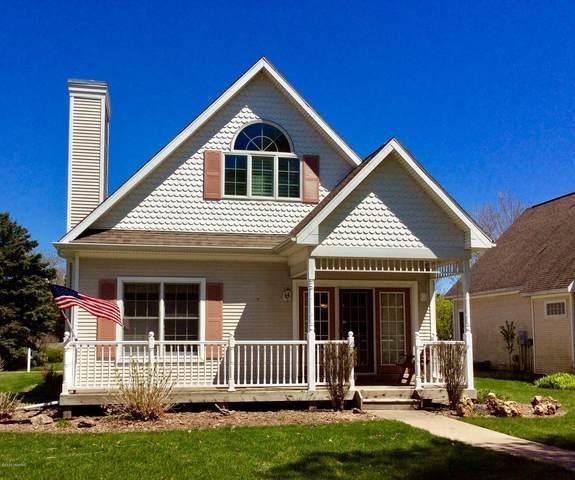 10 Cottage Lane, Manistee, MI 49660 (MLS #20017899) :: Deb Stevenson Group - Greenridge Realty