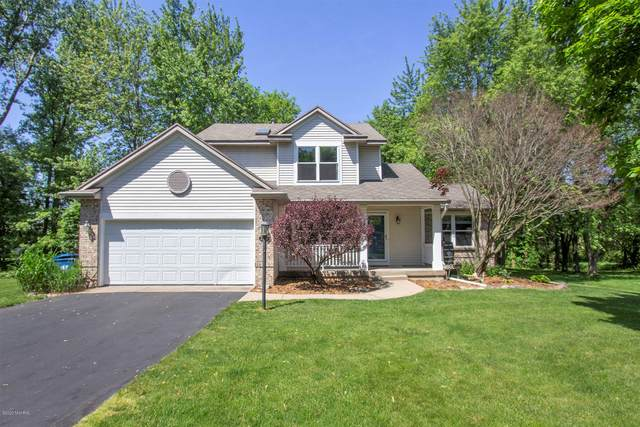 2100 Highlander Drive SE, Kentwood, MI 49508 (MLS #20019874) :: Keller Williams RiverTown