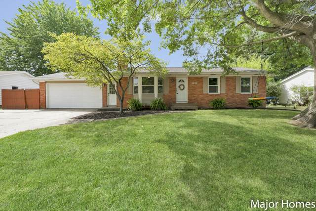 3920 Blackhawk Drive SW, Grandville, MI 49418 (MLS #20031054) :: Jennifer Lane-Alwan