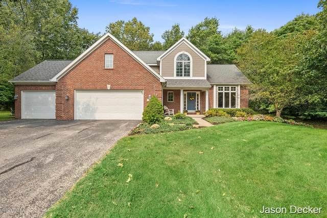 5187 Glen Oaks Drive NE, Rockford, MI 49341 (MLS #20039013) :: Ginger Baxter Group