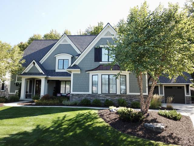 5807 Manchester Hills Drive SE, Grand Rapids, MI 49546 (MLS #20039364) :: Ron Ekema Team