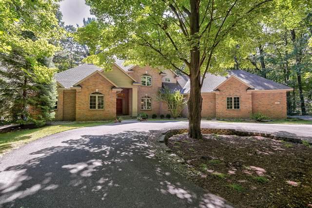 16850 Shore Oaks East Lane, Holland, MI 49424 (MLS #20039473) :: JH Realty Partners