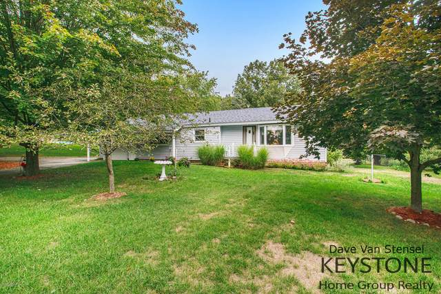 1103 11 Mile Road NE, Comstock Park, MI 49321 (MLS #20039947) :: JH Realty Partners