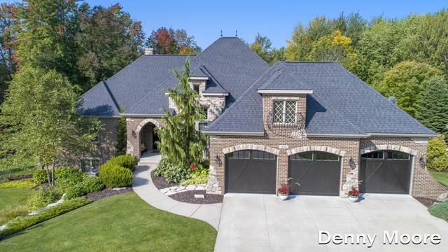 5808 Manchester Hills Drive SE, Grand Rapids, MI 49546 (MLS #20040432) :: Ginger Baxter Group