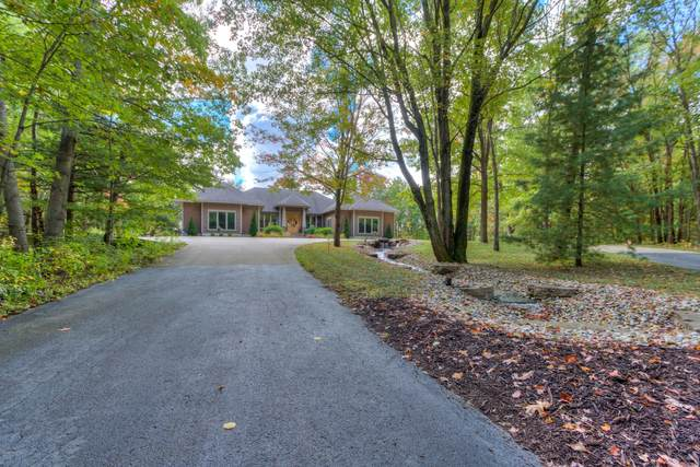 7211 Harvey Road, Norton Shores, MI 49456 (MLS #20040954) :: JH Realty Partners