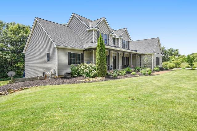 9954 Coldwater Creek NE, Rockford, MI 49341 (MLS #20049100) :: Ginger Baxter Group