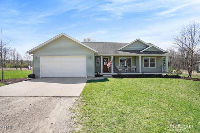 1706 Rector Street NE, Rockford, MI 49341 (MLS #21012076) :: Deb Stevenson Group - Greenridge Realty