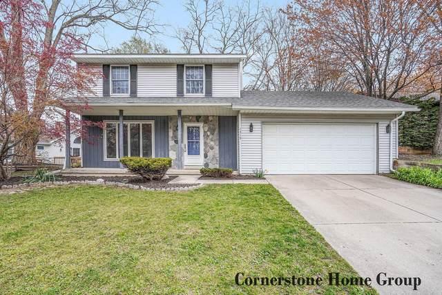 1319 Morewood Drive SE, Grand Rapids, MI 49508 (MLS #21013437) :: JH Realty Partners