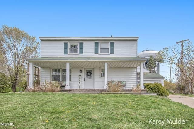 1073 Lockridge Drive NE, Grand Rapids, MI 49505 (MLS #21013512) :: JH Realty Partners