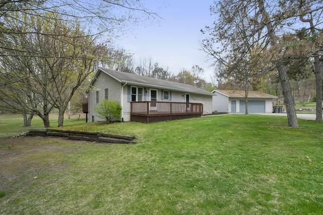 724 Hillside Court SE, Lowell, MI 49331 (MLS #21013596) :: JH Realty Partners