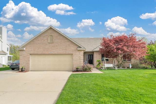 4061 Bulrush Drive NW, Walker, MI 49534 (MLS #21015587) :: Your Kzoo Agents