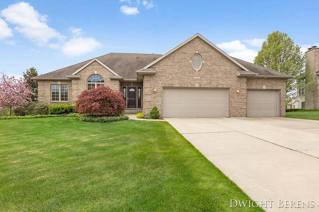 980 River Rock Drive NE, Comstock Park, MI 49321 (MLS #21016414) :: Ginger Baxter Group