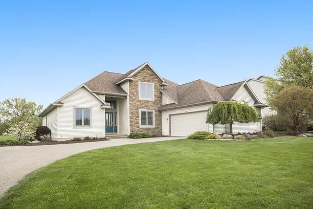 7810 Golf Meadows Drive SE, Caledonia, MI 49316 (MLS #21016886) :: JH Realty Partners