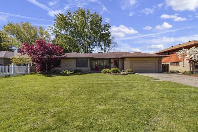 3810 Navaho Street SW, Grandville, MI 49418 (MLS #21016980) :: JH Realty Partners