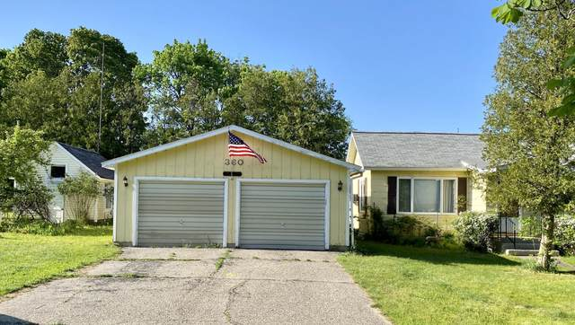 360 9th Street, Manistee, MI 49660 (MLS #21021485) :: Deb Stevenson Group - Greenridge Realty