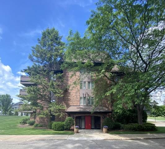 3181 Charlevoix Drive SE #103, Grand Rapids, MI 49546 (MLS #21021494) :: BlueWest Properties