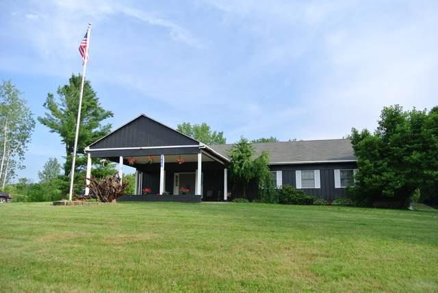 1480 Indian Lakes Road NE, Sparta, MI 49345 (MLS #21026857) :: Deb Stevenson Group - Greenridge Realty