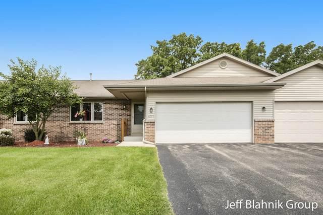 4295 Oakridge Drive NW, Grand Rapids, MI 49534 (MLS #21094799) :: JH Realty Partners