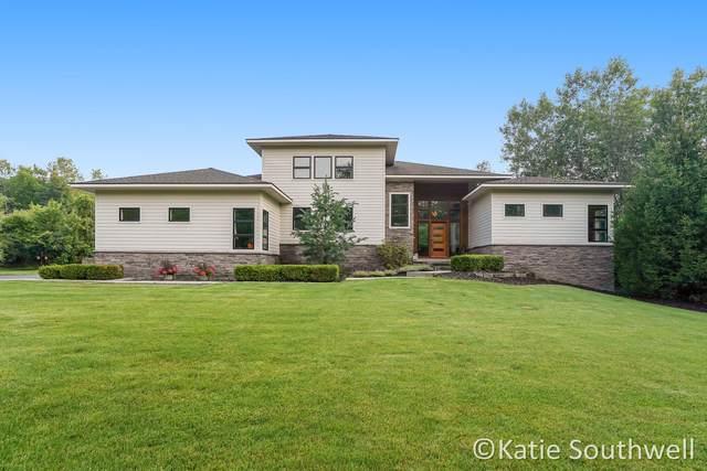 830 Skyevale NE, Ada, MI 49301 (MLS #21095570) :: BlueWest Properties