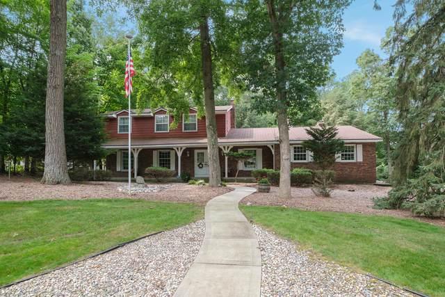 7484 Lime Hollow Drive SE, Grand Rapids, MI 49546 (MLS #21097013) :: BlueWest Properties