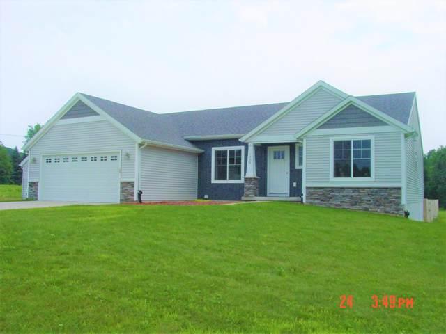 1230 Indian Lakes Road NE, Sparta, MI 49345 (MLS #21097290) :: Deb Stevenson Group - Greenridge Realty