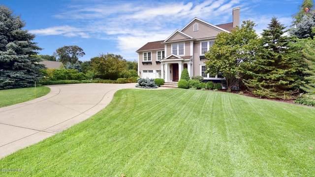 6839 W Wiley Road, Douglas, MI 49406 (MLS #21097912) :: JH Realty Partners