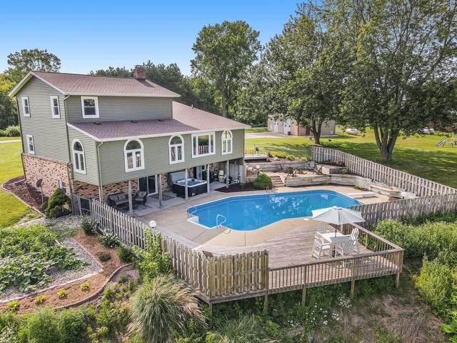 551 E Randall Street, Coopersville, MI 49404 (MLS #21098193) :: BlueWest Properties