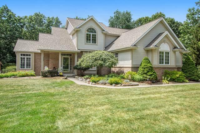 7855 Newport Avenue NE, Rockford, MI 49341 (MLS #21098629) :: BlueWest Properties
